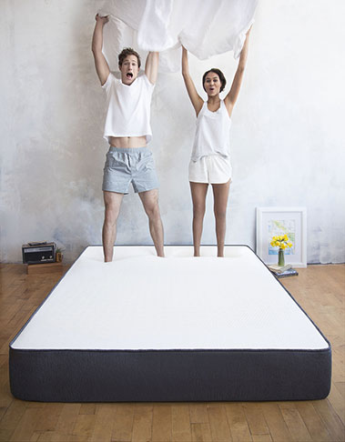 two people jumping on casper mattress image