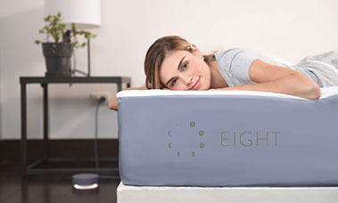 photo of girl laying on eight sleep mattress