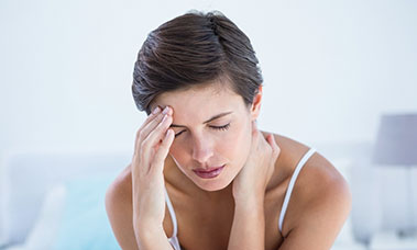 women with a headache from sleep apnea
