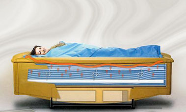 woman laying on water mattress image