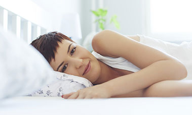 woman lying on her side smiling