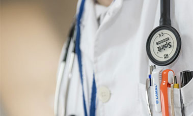 white doctors outfit with stethoscope