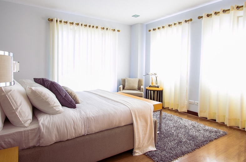 image showing beige themed bedroom during daytime