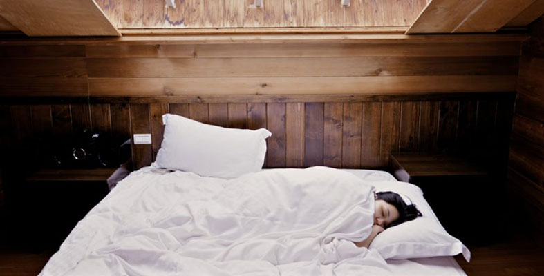 image of the sleepy woman in the bed