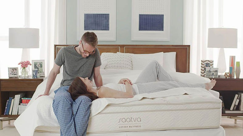 couple lying on saatva bed