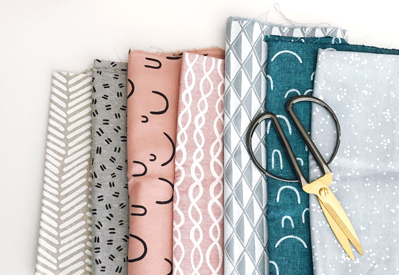 image showing patterned fabric and scissors