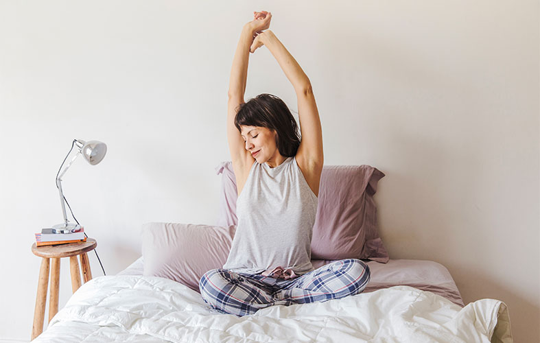 woman stretching and waking up