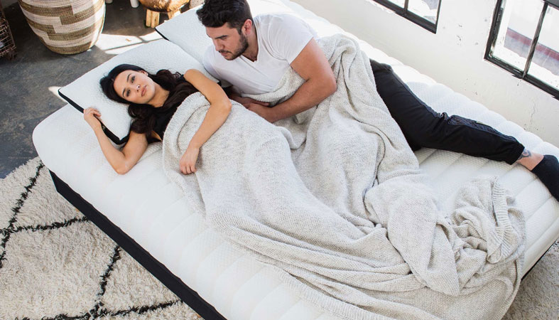 woman and man lie on luxi bed