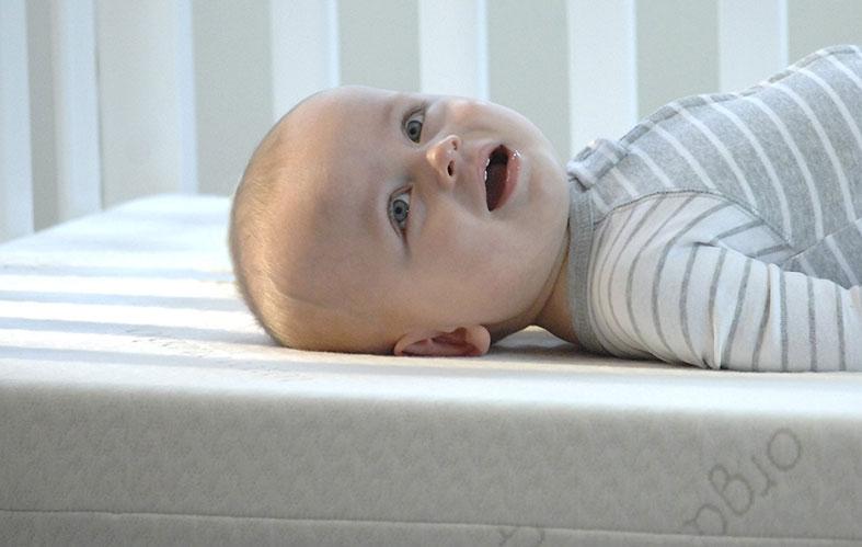 happy baby on waterproof mattress