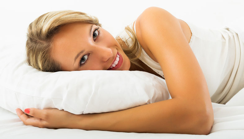 happy woman lies on her stomach