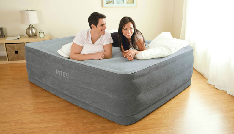 the couple laying on the air mattress in a bedroom