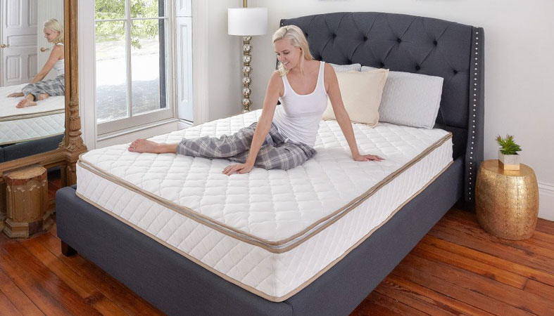 woman sitting on innerspring mattress