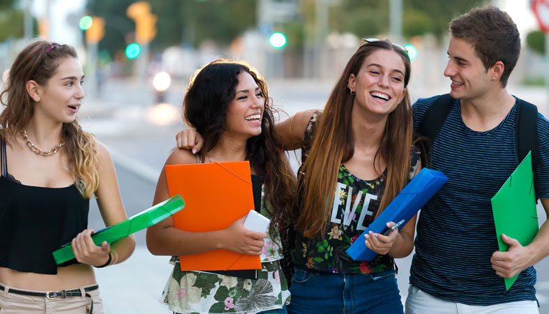 Happy students are talking on the street