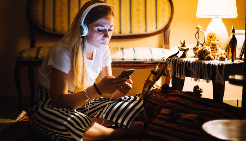 woman is listening music at night