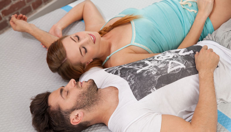 young couple sleeps on the bed