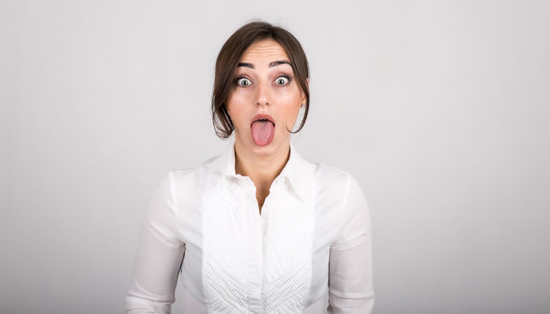 woman is doing some tongue and throat exercises