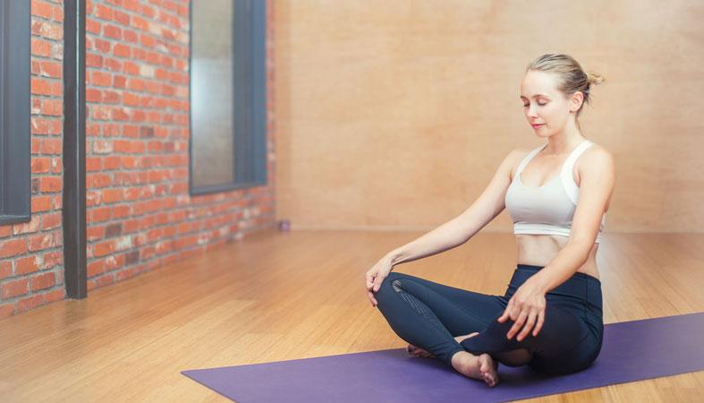 woman is exercising yoga