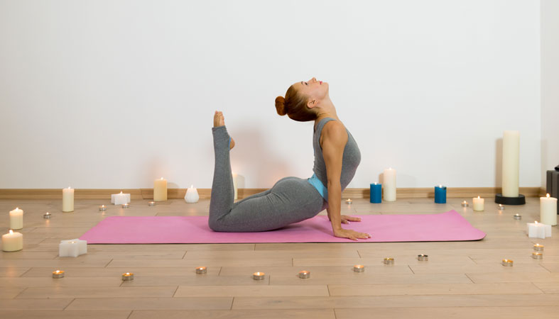 woman practicing yoga in the house