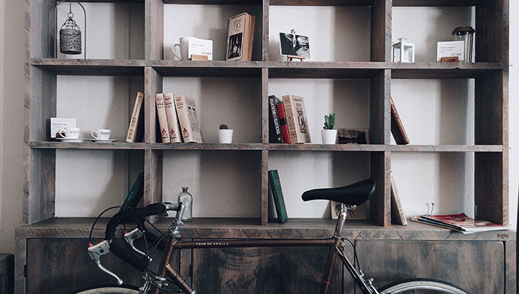 Bookshelf with a bike