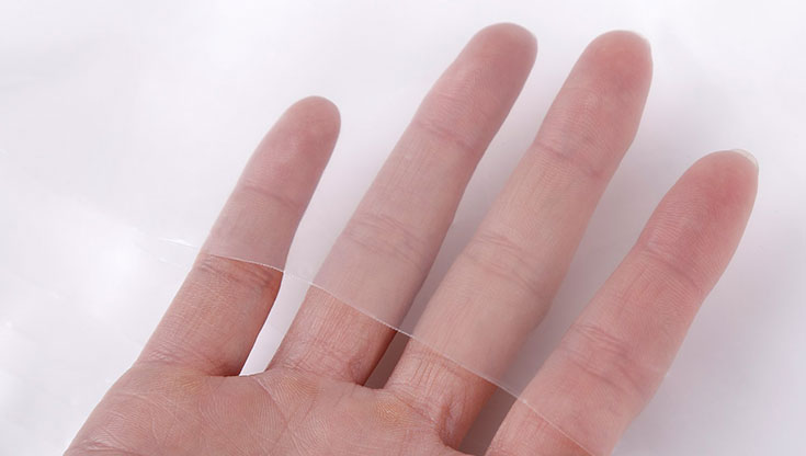 Hand is holding plastic transparent material