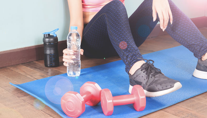 fitness woman holding bottle of water