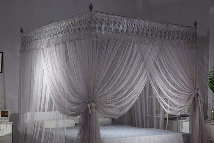 grey curtains above the bed