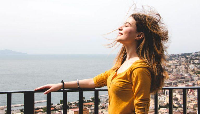 woman enjoys the wind