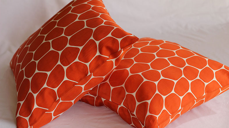 Two orange pillows