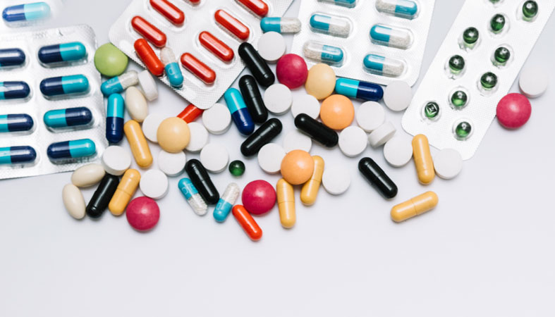 heap of tablets and pills