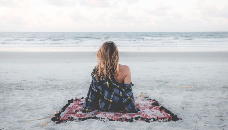 woman is relaxing on the beach