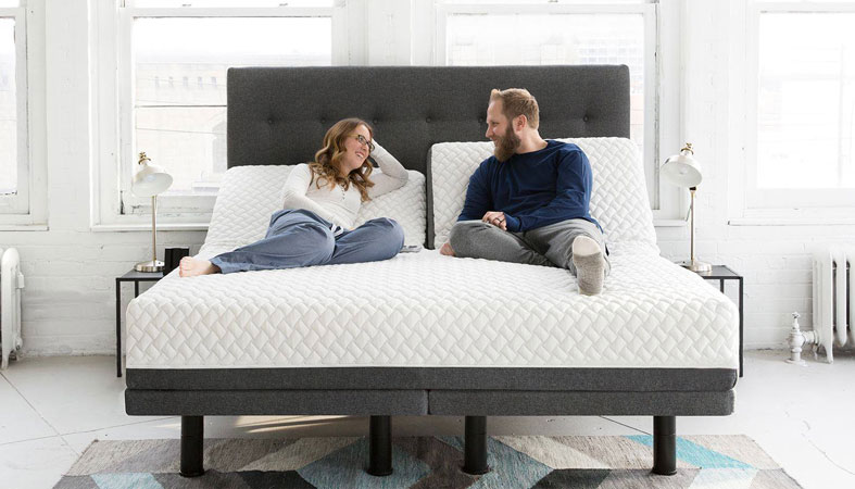 happy couple lying on smart bed