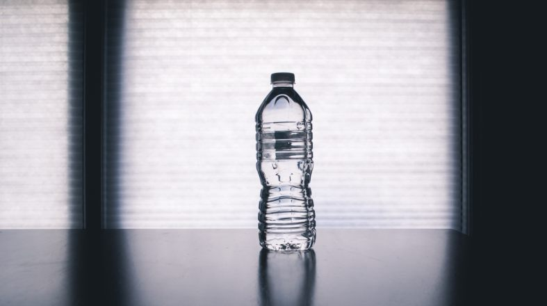 photo of bottle of the water on the dark table