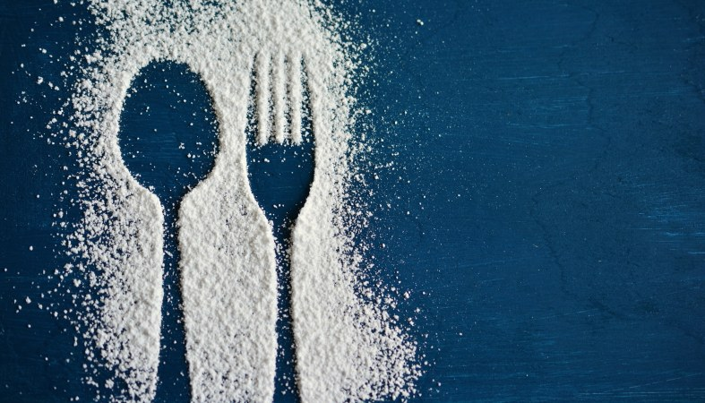 a shape of the spoon and fork made of powder sugar