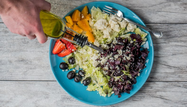 fresh salad of vegetables and fruits in the blue plate