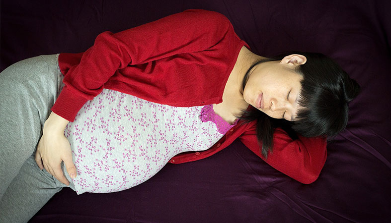 Pregnant woman is sleeping