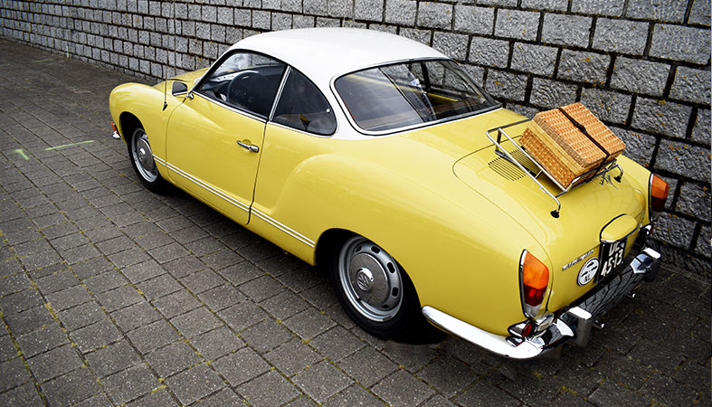 A yellow old classy vehicle