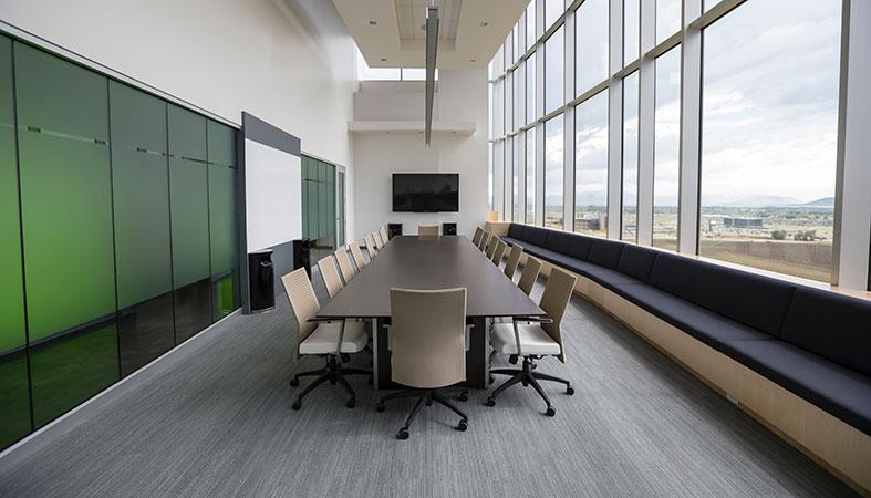 a meeting room with big windows