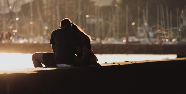 couple enjoys by the river