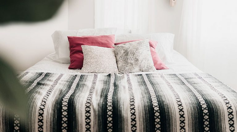 tidy bed with beautiful pillows