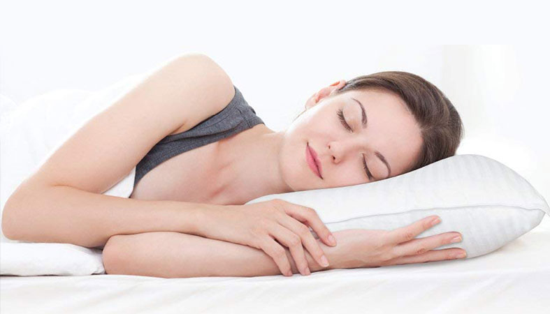 woman is peacefully sleeping on the pillow