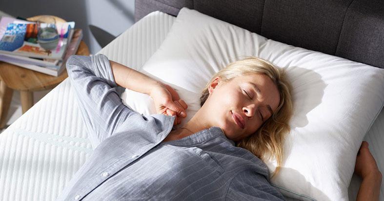 beautiful woman is sleep on tempur bed