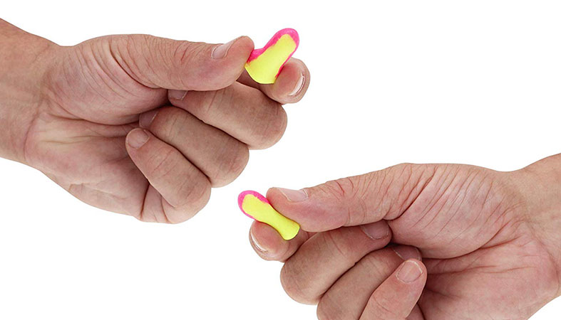 hands are holding the earplugs for sleeping