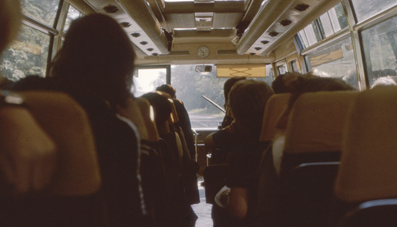 retro photo of people on the bus