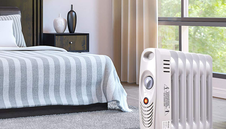 a bedroom with an oil filled radiator in it