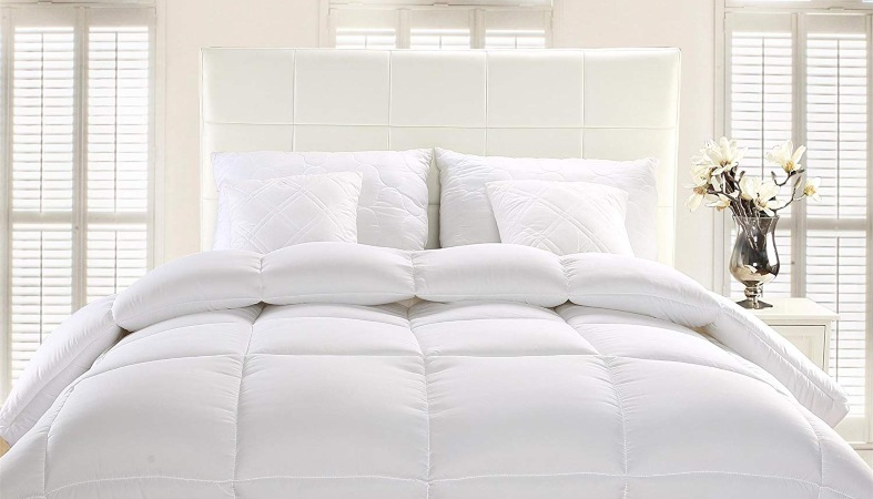 beautiful white bed with an comforter