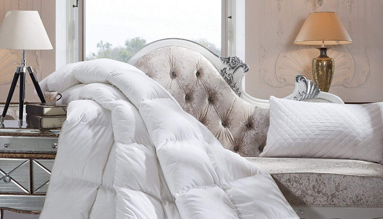 image of a down comforter on a luxury sofa