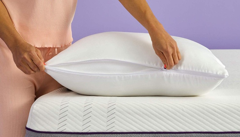image - woman is setting up the pillow