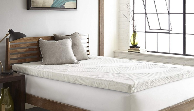 an image of a bed with the mattress pad on it