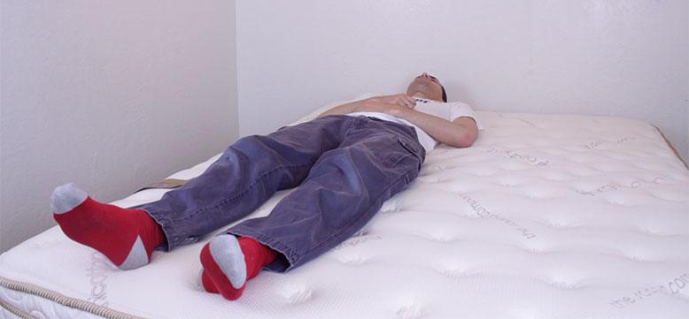 Stuart Lying on His Back on Saatva