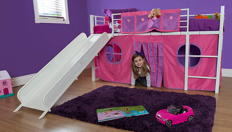 a girl is playing under the loft bed